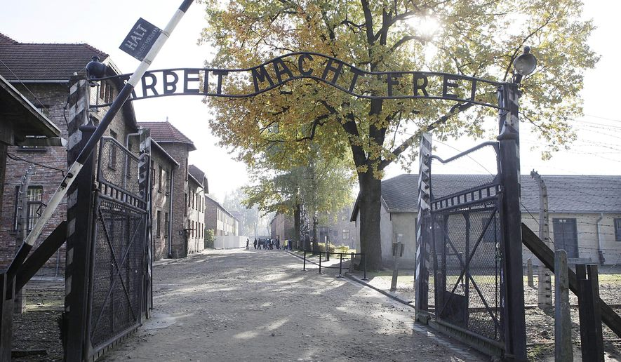 "FILE - This Oct. 19, 2012 file photo shows the entrance of Auschwitz at the former Nazi German death complex of Auschwitz-Birkenau in in Oswiecim, Poland. The memorial museum is asking Germans and Austrians to donate private letters, memoirs, photos and any other items that could help historians better understand the mentality of the Holocaust's perpetrators. The museum said Wednesday, Jan 18, 2017, it seeks ""to better understand the influence of populist mechanisms of hatred for human beings."" (AP Photo/Czarek Sokolowski, File)"