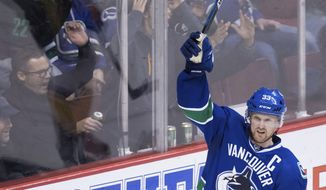 Vancouver Canucks' Henrik Sedin, of Sweden, celebrates his goal against the Nashville Predators during the third period of an NHL hockey game Tuesday, Jan. 17, 2017, in Vancouver, British Columbia. (Darryl Dyck/The Canadian Press via AP)
