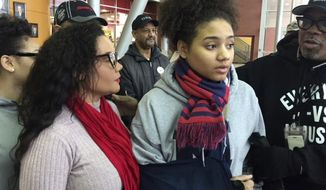 In this Tuesday, Jan. 17, 2017 photo, Gabrielle Stokes, daughter of singer Sara Stokes, left, speaks to the media in Warren, Mich. Gabrielle Stokes alleges she was dragged out of her apartment and suffered injuries during a Jan. 3 arrest in Warren. (Nicquel Terry/Detroit News via AP)
