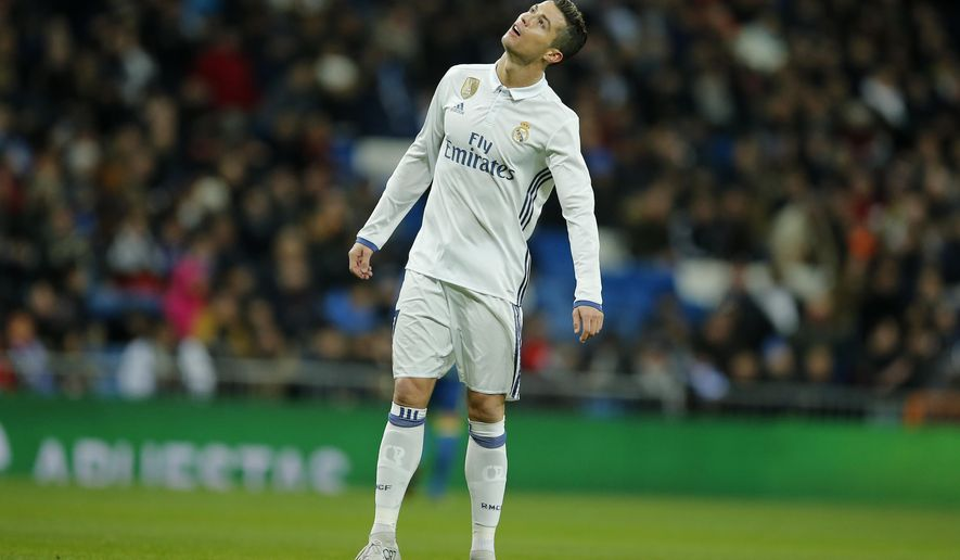 Real Madrid's Cristiano Ronaldo reacts during a Copa del Rey, quarter final, 1st leg soccer match between Real Madrid and Celta at the Santiago Bernabeu stadium in Madrid, Spain, Wednesday Jan. 18, 2017. (AP Photo/Paul White)