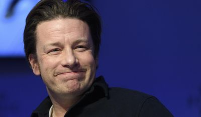 British chef Jamie Oliver attends a panel session during the 47th annual meeting of the World Economic Forum, WEF, in Davos, Switzerland, Wednesday, Jan. 18, 2017. (Laurent Gillieron/Keystone via AP)