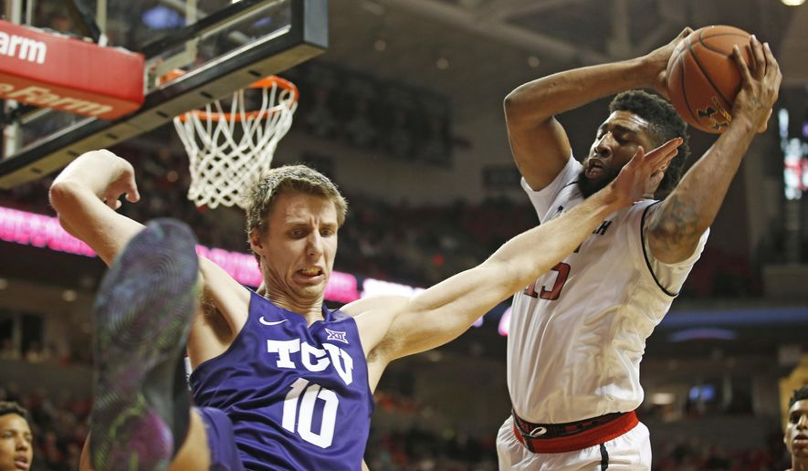Texas Tech's Aaron Ross (15) takes the rebound away from TCU's Vladimir Brodziansky (10) during an NCAA college basketball game Wednesday, Jan. 18, 2017, in Lubbock, Texas. (Brad Tollefson/Lubbock Avalanche-Journal via AP)