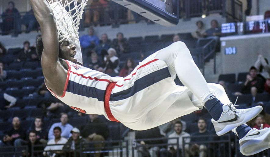 Mississippi guard Terence Davis (3) dunks against Tennessee during an NCAA college basketball game in Oxford, Miss. on Tuesday, Jan. 17, 2017. (Bruce Newman/Oxford Eagle via AP)
