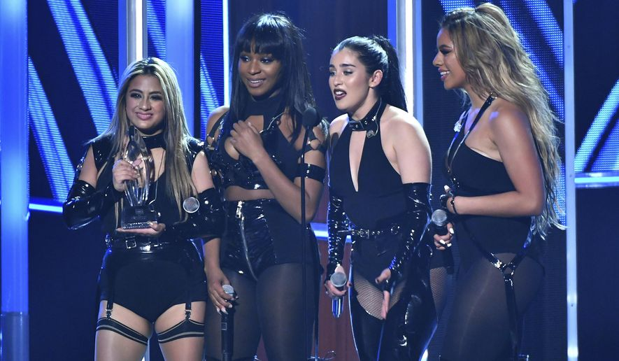 Ally Brooke, from left, Normani Hamilton, Lauren Jauregui, and Dinah Jane of the musical group Fifth Harmony accept the award for favorite group at the People's Choice Awards at the Microsoft Theater on Wednesday, Jan. 18, 2017, in Los Angeles. (Photo by Vince Bucci/Invision/AP)
