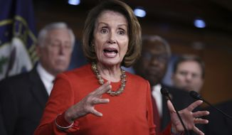 House Minority Leader Nancy Pelosi of Calif., together with Democratic House members, speaks to reporters about the Affordable Care Act, Thursday, Jan. 19, 2017, on Capitol Hill in Washington. (AP Photo/Manuel Balce Ceneta)