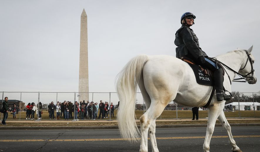 A mounted police officer patrols near the Washington Memorial in Washington, Thursday, Jan. 19, 2017, as preparations continue for Friday's presidential inauguration. (AP Photo/John Minchillo)