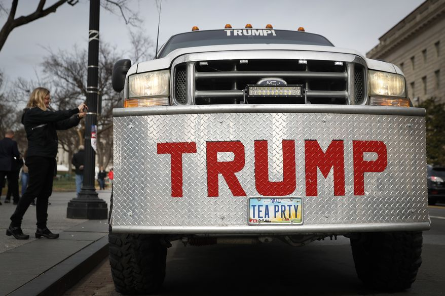 A truck bearing the name of President-elect Donald Trump is parked near the National Mall in Washington, Thursday, Jan. 19, 2017, as preparations for Friday's presidential inauguration. (AP Photo/John Minchillo)