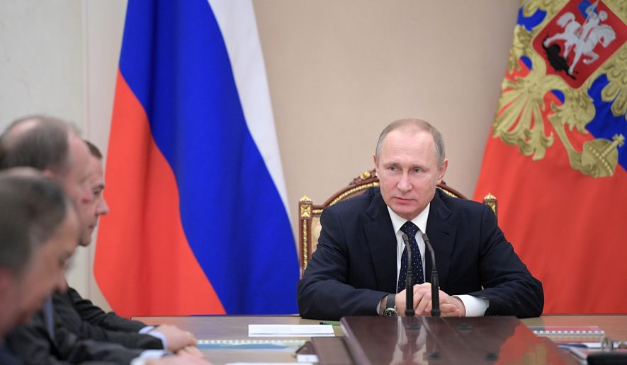 Russian President Vladimir Putin chairs a government meeting in the Kremlin in Moscow, Russia, Thursday, Jan. 19, 2017. (Alexei Druzhinin/Sputnik, Kremlin Pool Photo via AP)