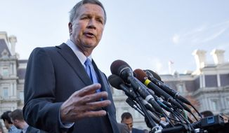 Ohio Gov. John Kasich, following a ceremony where President Barack Obama honored the 2016 NBA champion Cleveland Cavaliers basketball team, answers questions from reporters outside the West Wing of the White House in Washington on Nov. 10, 2016. (Associated Press) **FILE**