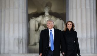 "President-elect Donald Trump, left, and his wife Melania Trump arrive to the ""Make America Great Again Welcome Concert"" at the Lincoln Memorial, Thursday, Jan. 19, 2017, in Washington. (AP Photo/Evan Vucci)"