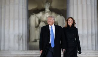 "President-elect Donald Trump, left, and his wife Melania Trump arrive to the ""Make America Great Again Welcome Concert"" at the Lincoln Memorial, Thursday, Jan. 19, 2017, in Washington. (AP Photo/Evan Vucci) ** FILE **"