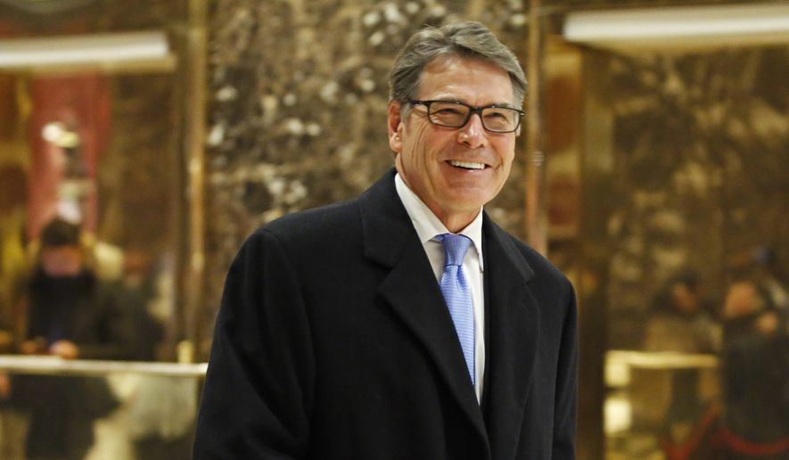Former Texas Gov. Rick Perry smiles as he leaves Trump Tower in New York in this Dec. 12, 2016, file photo. (AP Photo/Kathy Willens, File)