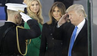 "President-elect Donald Trump salutes as he arrives with his wife Melania Trump at a pre-Inaugural ""Make America Great Again! Welcome Celebration"" at the Lincoln Memorial in Washington, Thursday, Jan. 19, 2017. Watching is daughter Ivanka, second from left. (AP Photo/David J. Phillip)"