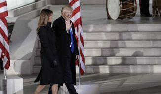 "President-elect Donald Trump and his wife Melania Trump walk at a pre-Inaugural ""Make America Great Again! Welcome Celebration"" at the Lincoln Memorial in Washington, Thursday, Jan. 19, 2017. (AP Photo/David J. Phillip)"