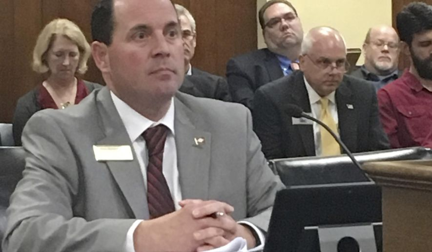 Arkansas state Rep. Andy Mayberry waits as the House Public Health, Welfare and Labor Committee votes on his proposal to restrict dilation and evacuation abortions Thursday, Jan. 19, 2017, at the State Capitol in Little Rock, Ark. The panel agreed to the restrictions on a voice vote. If Mayberry's ban becomes law, Arkansas would be the third state to prohibit the procedure, behind Mississippi and West Virginia. (AP Photo/Kelly P. Kissel)