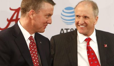 Alabama President Stuart Bell, right, speaks with new athletics director Greg Byrne, Thursday, Jan. 19, 2017 in Tuscaloosa, Ala. (Gary Cosby Jr./The Tuscaloosa News via AP)