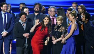 """The cast and crew of """"The Big Bang Theory"""" accept the award for favorite network TV comedy at the People's Choice Awards at the Microsoft Theater on Wednesday, Jan. 18, 2017, in Los Angeles. (Photo by Vince Bucci/Invision/AP) ** FILE **"""