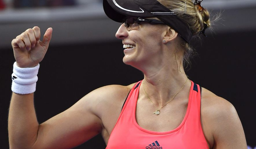 Croatia's Mirjana Lucic-Baroni celebrates after defeating Poland's Agnieszka Radwanska in their second round match at the Australian Open tennis championships in Melbourne, Australia, Thursday, Jan. 19, 2017. (AP Photo/Andy Brownbill)