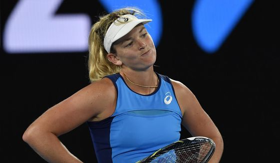 United States' Coco Vandeweghe reacts while playing Canada's Eugenie Bouchard during their third round match at the Australian Open tennis championships in Melbourne, Australia, Friday, Jan. 20, 2017. (AP Photo/Andy Brownbill)