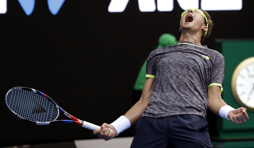 Uzbekistan's Denis Istomin celebrates after defeating Serbia's Novak Djokovic in their second round match at the Australian Open tennis championships in Melbourne, Australia, Thursday, Jan. 19, 2017. (AP Photo/Aaron Favila)