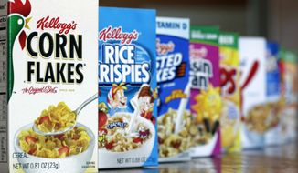 This Feb. 1, 2012, file photo shows Kellogg's cereal products in Orlando, Fla. Cereal makers have paid for studies that support the belief that eating breakfast can help keep us thin. The fact that cereal makers commissioned the studies doesn't mean breakfast is unhealthy, but it shows how difficult it can be to sort the hype from reliable dietary advice. (AP Photo/John Raoux, File)