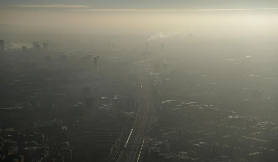 Pollution haze over South East London, through a window in a viewing area of the 95-storey skyscraper The Shard, the tallest building in Britain, in London, Thursday, Jan. 19, 2017. The London mayor's office says the city is experiencing a period of air pollution with pollution readings moderate to high across the city. (AP Photo/Matt Dunham)