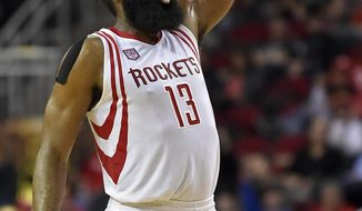 Houston Rockets guard James Harden watches his 3-point shot during the second half of the team's NBA basketball game against the Milwaukee Bucks, Wednesday, Jan. 18, 2017, in Houston. Houston won 111-92. (AP Photo/Eric Christian Smith)