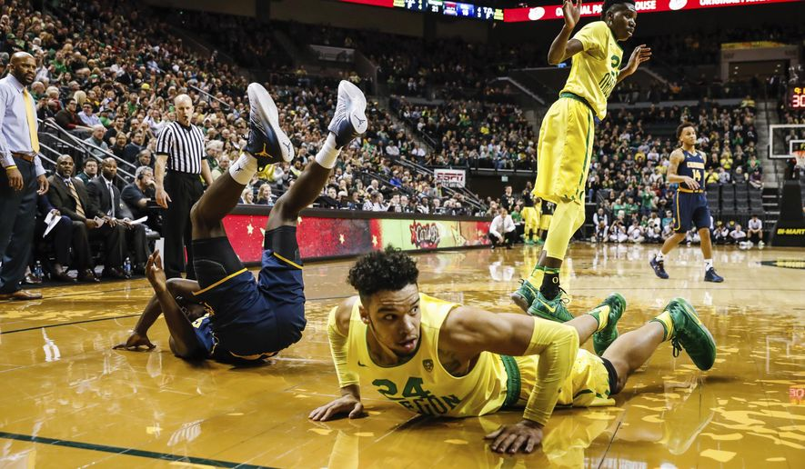 Oregon Ducks forward Dillon Brooks (24), collides in the first half against California in an NCAA college basketball game Thursday, Jan. 20, 2016, in Eugene, Ore. Brooks later left the game with an injury on a different play. (AP Photo/Thomas Boyd)