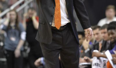Clemson's head coach Brad Brownell sends in a play to his team during the first half of an NCAA college basketball game against louisville, Thursday, Jan. 19, 2017, in Louisville, Ky. (AP Photo/Timothy D. Easley)