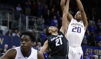Washington guard Markelle Fultz (20) shoots over Colorado guard Derrick White (21) during the first half of an NCAA college basketball game, Wednesday, Jan. 18, 2017, in Seattle. (AP Photo/Ted S. Warren)