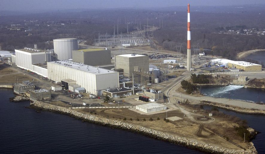 FILE - This March 18, 2003 aerial file photo shows the Millstone nuclear power facility in Waterford, Conn. As low energy prices put strains on operators of U.S. nuclear plants, some Connecticut lawmakers want in January 2017 to reduce any risk the Millstone Power Station will close by allowing it to sell power directly to the state. (AP Photo/Steve Miller, File)