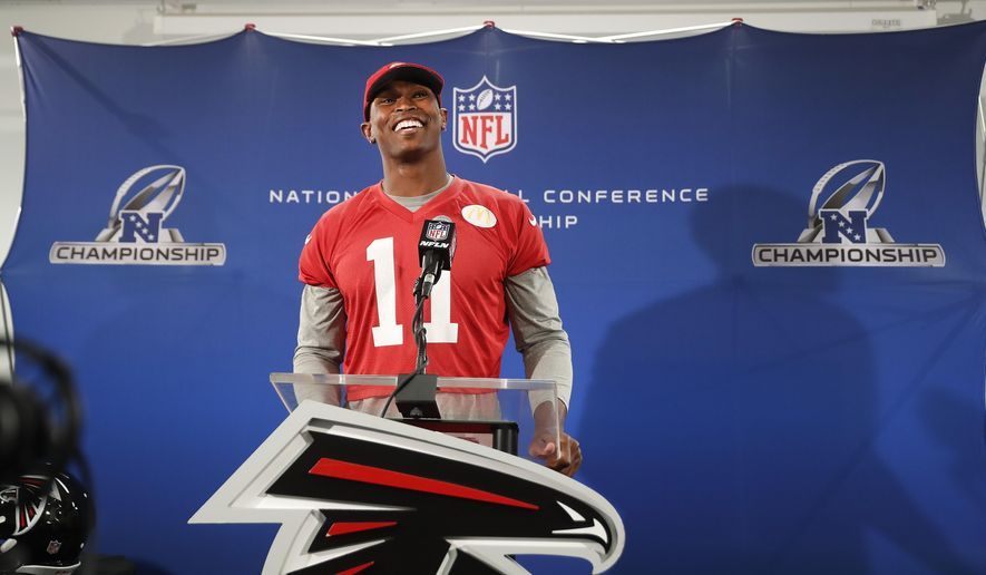Atlanta Falcons receiver Julio Jones smiles as he answer a question during a news conference before an NFL football practice , Thursday, Jan. 19, 2017, in Flowery Branch, Ga.. TheFalcons will face the Green Bay Packers in the NFC Championship on Sunday in Atlanta. (AP Photo/John Bazemore)