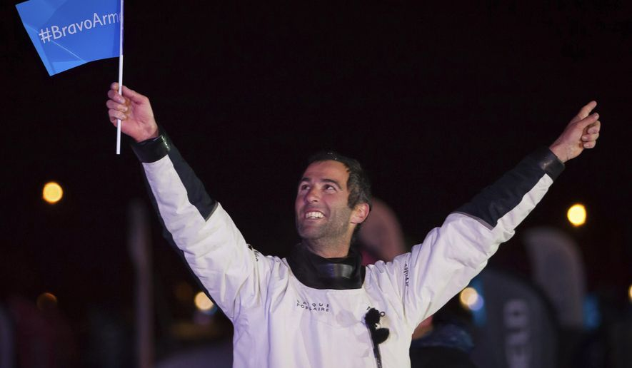 "French skipper Armel Le Cleac'h celebrates his victory aboard his ""Banque Populaire"" monohull after winning the Vendee Globe solo around-the-world sailing race in Les Sables d'Olonne harbor, western France, Thursday, Jan. 19, 2016. Le Cleac'h held off a late surge from British sailor Alex Thomson to win the Vendee Globe round-the-world race Thursday in record time. The 39-year-old Frenchman finished the race in 74 days. (AP Photo/Yohan Bonnet)"