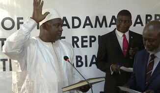 Adama Barrow is sworn in as President of Gambia at Gambia's embassy in Dakar Senegal in this image taken from TV  Thursday, Jan 19, 2017.  A new Gambian president has been sworn into office in neighboring Senegal, while Gambia's defeated longtime ruler refuses to step down from power, deepening a political crisis in the tiny West African country.(RTS via AP)