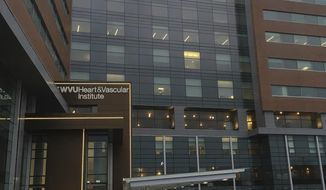 In this Jan. 17, 2017 photo, Ruby Memorial Hospital in Morgantown, W.Va., is seen. WVU Medicine this week opened a new 10-story tower at Ruby Memorial Hospital adding more than 800 jobs and 100 patient rooms in the expansion. Its cardiac and vascular medicine institute has moved there. (AP Photo/Michael Virtanen)