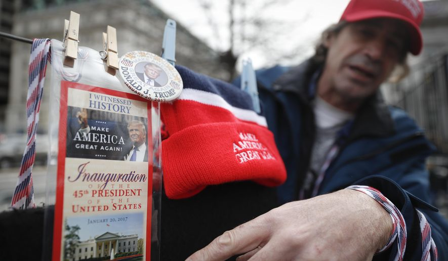 Vendors sell their President-elect Donald Trump wares in Washington, Thursday, Jan. 19, 2017, as preparations continue for Friday's presidential inauguration. (AP Photo/John Minchillo)