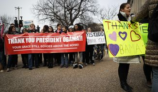 Demonstrators gather near the White House in Washington, Thursday, Jan. 19, 2017, to thank outgoing President Barack Obama as preparations continue for Friday's presidential inauguration. (AP Photo/John Minchillo)