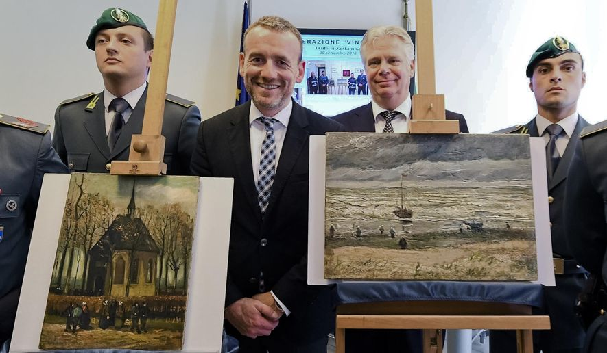 FILE- In this  Friday, Sept. 30, 2016 file photo, Director of Amsterdam's Van Gogh Museum Axel Rueger, center, stands next to the paintings 'Congregation Leaving The Reformed Church of Nuenen', left, and 1882 'Seascape at Scheveningen' by Vincent Van Gogh, during a press conference in Naples, Italy.  Two paintings by Vincent van Gogh that were stolen in 2002 from the Amsterdam museum that is named for the Dutch master and recovered last year by Italian police are set to be returned. (Ciro Fusco/ANSA via AP, file)
