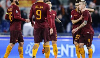Roma's Radja Nainggolan, right, celebrates with his teammates after scoring during an Italian Cup, round of 16, soccer match between Roma and Sampdoria, at Rome's Olympic stadium, Thursday, Jan. 19, 2017.  (Angelo Carconi/ANSA via AP)
