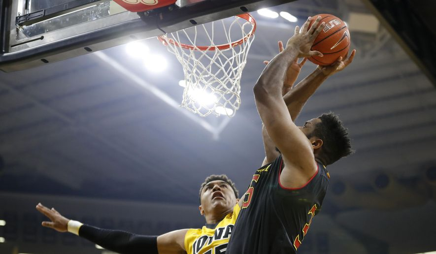 Maryland forward Damonte Dodd, right, shoots over Iowa forward Cordell Pemsl during the first half of an NCAA college basketball game, Thursday, Jan. 19, 2017, in Iowa City, Iowa. (AP Photo/Charlie Neibergall)