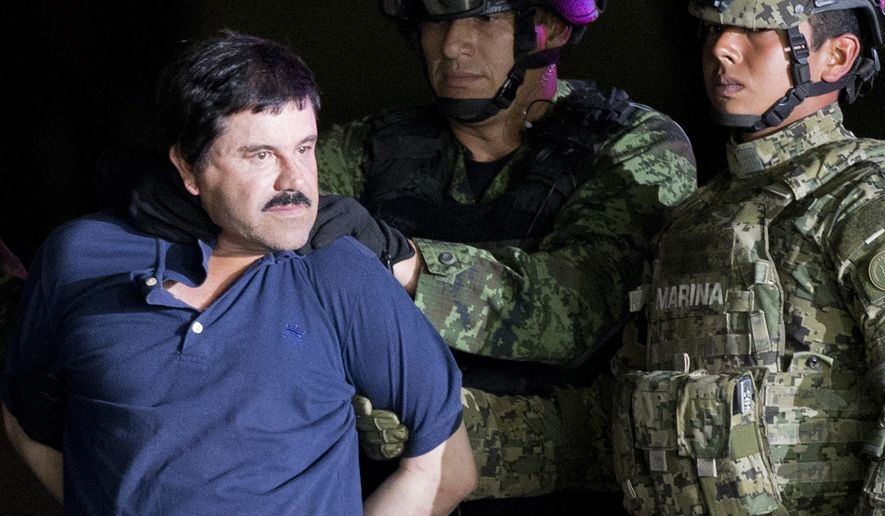 "In this Jan. 8, 2016, file photo, a handcuffed Joaquin ""El Chapo"" Guzman is made to face the press as he is escorted to a helicopter by Mexican soldiers and marines at a federal hangar in Mexico City. According to Mexico's Foreign Ministry, Guzman has been extradited to the United States on Thursday, Jan. 19 2017.  (AP Photo/Eduardo Verdugo, File)"