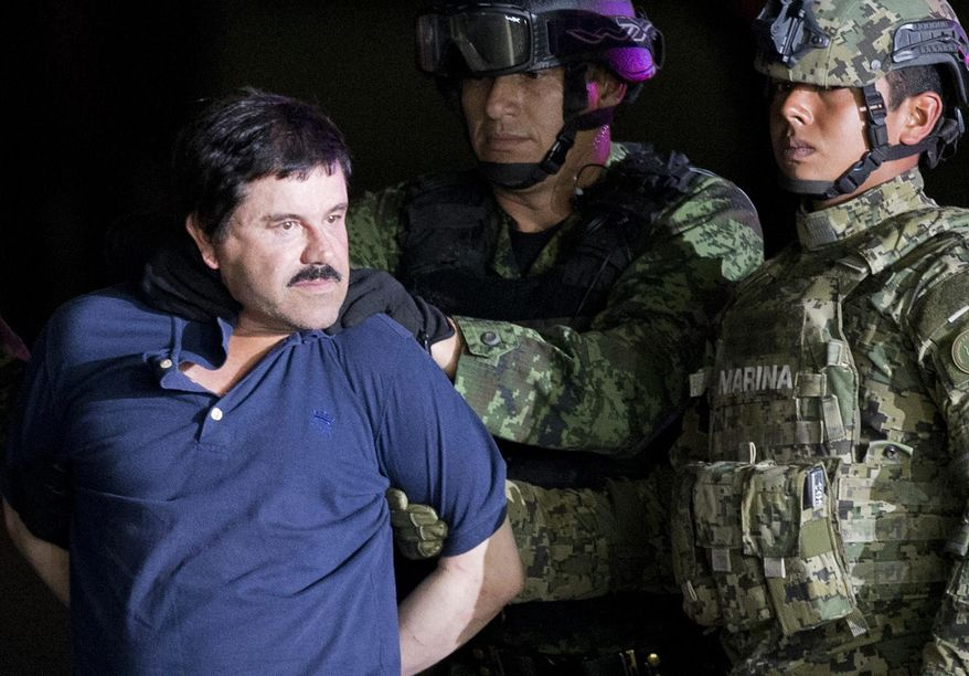 """In this Jan. 8, 2016, file photo, a handcuffed Joaquin """"El Chapo"""" Guzman is made to face the press as he is escorted to a helicopter by Mexican soldiers and marines at a federal hangar in Mexico City. According to Mexico's Foreign Ministry, Guzman has been extradited to the United States on Thursday, Jan. 19 2017.  (AP Photo/Eduardo Verdugo, File)"""