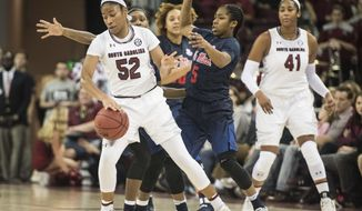 South Carolina guard Tyasha Harris (52) dribbles the ball against Mississippi guard Erika Sisk (5) during the first half of an NCAA college basketball game Thursday, Jan. 19, 2017, in Columbia, S.C. (AP Photo/Sean Rayford)
