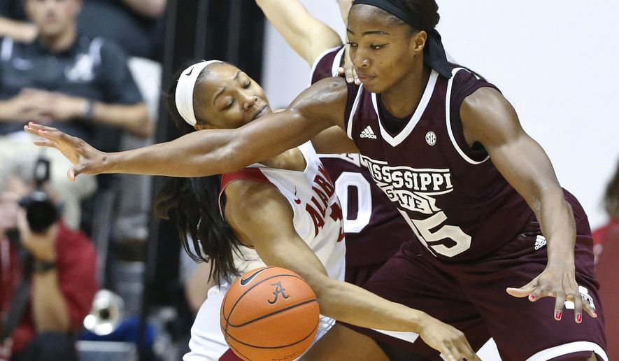 Mississippi State center Chinwe Okorie defends Alabama guard Meoshonti Knight, left, during the first half of an NCAA college basketball game, Thursday, Jan. 19, 2017, in Tuscaloosa, Ala. (AP Photo/Brynn Anderson)