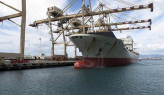 In this Sept. 16, 2013 file photo, a Maston ship sits in Honolulu Harbor near the site of a molasses spill. The U.S. Environmental Protection Agency has reached a settlement with the shipping company responsible for the 1,400-ton molasses spill in Honolulu Harbor in 2013. The federal agency announced in a statement Thursday, Jan. 19, 2017 that Matson Terminals Inc. will pay a civil penalty of $725,000. The molasses leaked from a section of pipe that had been flagged by the state a year before the spill. (AP Photo/Oskar Garcia, File)