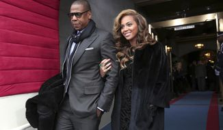 "FILE - This Jan. 21, 2013 file photo shows recording artists Jay-Z and Beyonce arriving on the West Front of the Capitol in Washington for the Presidential Barack Obama's ceremonial swearing-in ceremony during the 57th Presidential Inauguration. President Barack Obama embraced hip-hop more than any of his predecessors. He once referenced Jay Z's lyrics, released his music playlist including several rappers from Chance the Rapper to Lil Wayne and was caught dancing to Drake's ""Hot Line Bling"" at a White House event. (AP Photo/Win McNamee, Pool)"