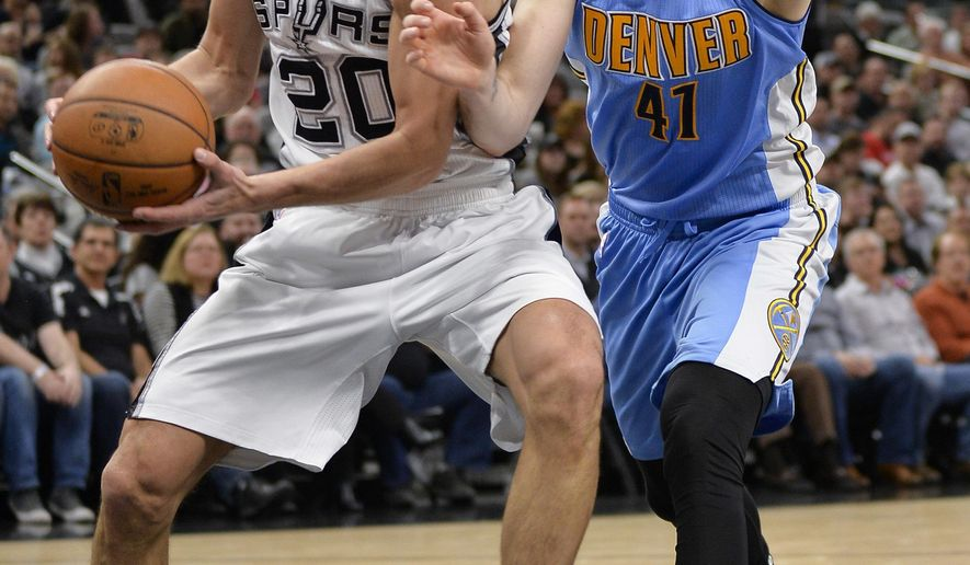 San Antonio Spurs guard Manu Ginobili (20), of Argentina, looks to pass around Denver Nuggets forward Juancho Hernangomez, of Spain, during the first half of an NBA basketball game, Thursday, Jan. 19, 2017, in San Antonio. (AP Photo/Darren Abate)