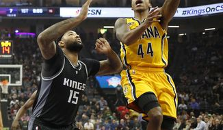 Indiana Pacers guard Jeff Teague, right, goes to the basket against Sacramento Kings center DeMarcus Cousins during the first half of an NBA basketball game Wednesday, Jan. 18, 2017, in Sacramento, Calif. (AP Photo/Rich Pedroncelli)