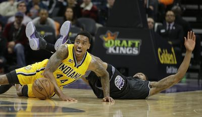 Indiana Pacers guard Jeff Teague, left, and Sacramento Kings forward Rudy Gay hit the floor as they scramble after the ball during the first half of an NBA basketball game Wednesday, Jan. 18, 2017, in Sacramento, Calif. (AP Photo/Rich Pedroncelli)