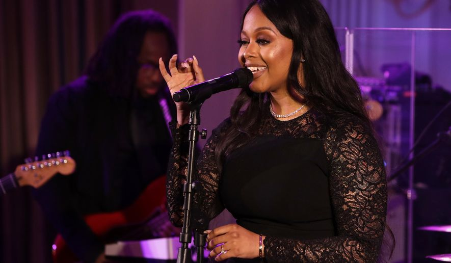 In this Aug. 2, 2016, file photo, singer Chrisette Michele performs for President Barack Obama, first lady Michelle Obama, Singapore's Prime Minister Lee Hsien Loong, and his wife Ho Ching, in the State Dining Room of the White House during a state dinner in Washington. The New York Daily News reported on Jan. 18, 2017, that Michele would perform at President-elect Donald Trump's inauguration Jan. 20, 2017. (AP Photo/Jacquelyn Martin, File)